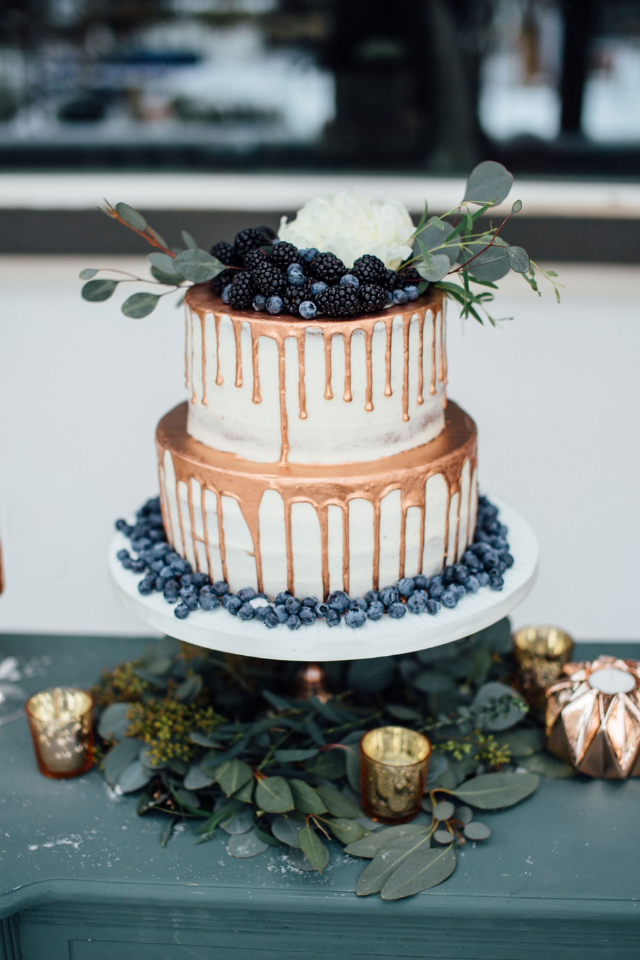 Gold drip naked cake with berries