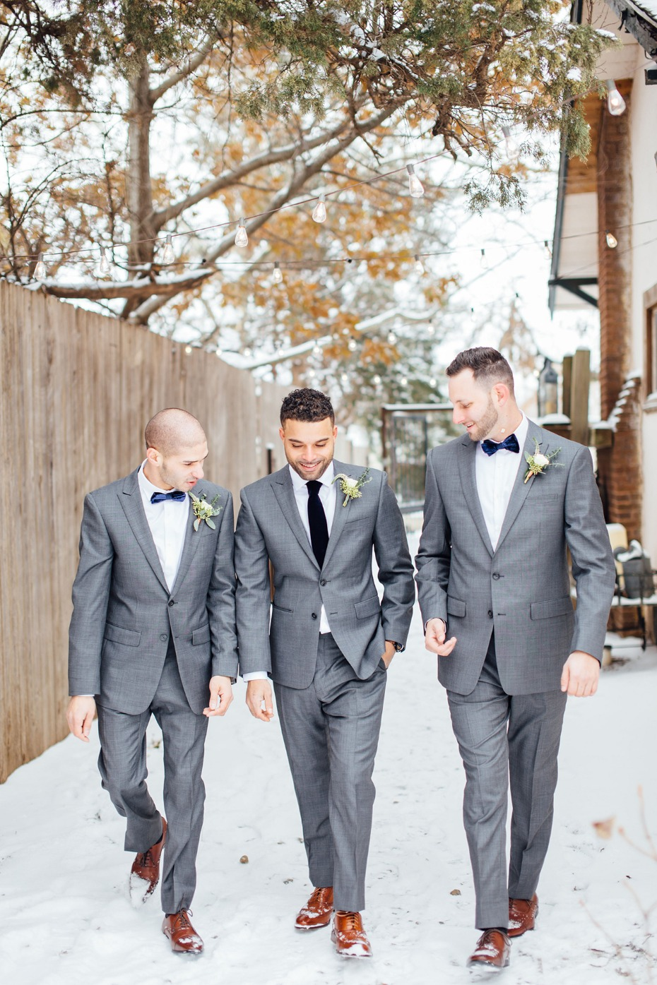 Grey suits and black ties