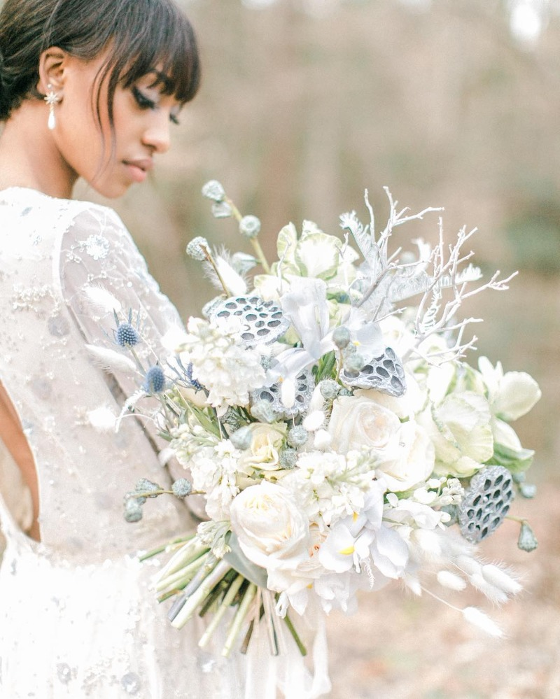 We are in love with this winter bouquet! Rhapsody in Blooms is always creating magic.