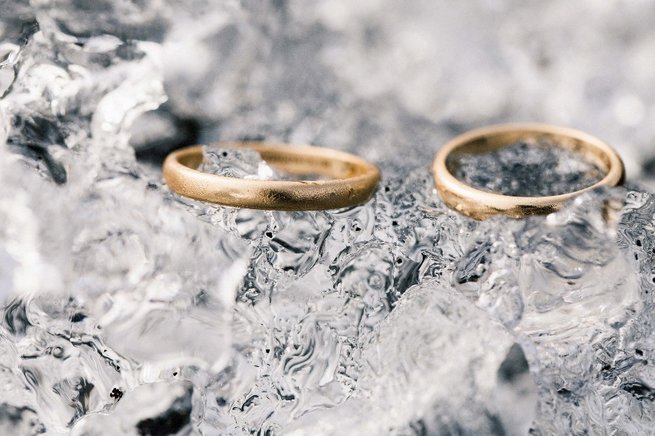 simple gold wedding rings on ice