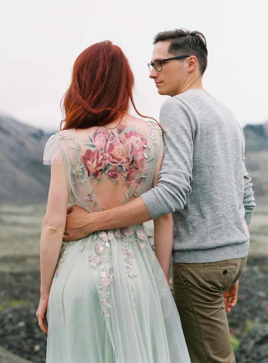 wedding dress that perfectly frames the bride to be's floral tattoo