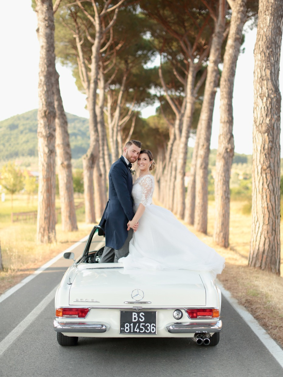 Love this vintage getaway car for a Tuscan wedding