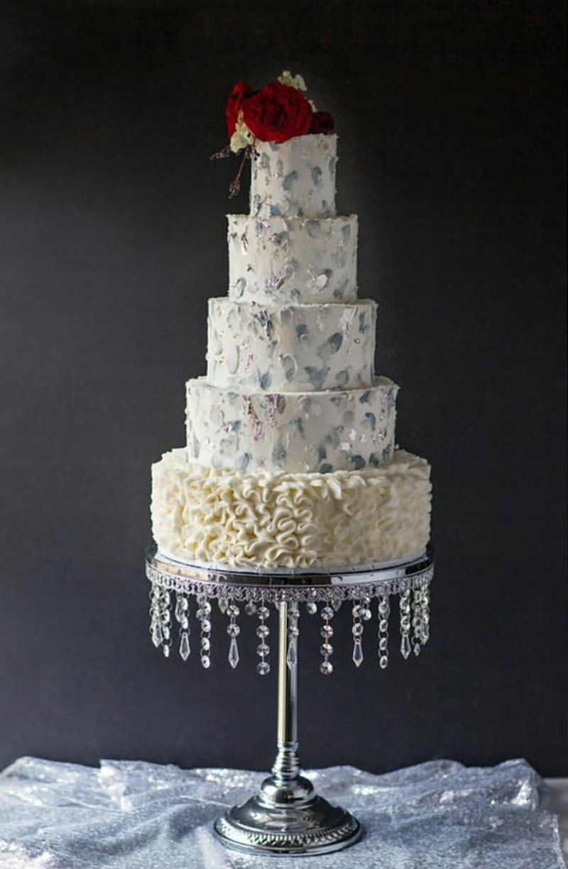 Metallic Winter Wedding Cake by Madison's on Main Cakes looking elegant on shiny silver cake stand with dangling jewels by Opulent