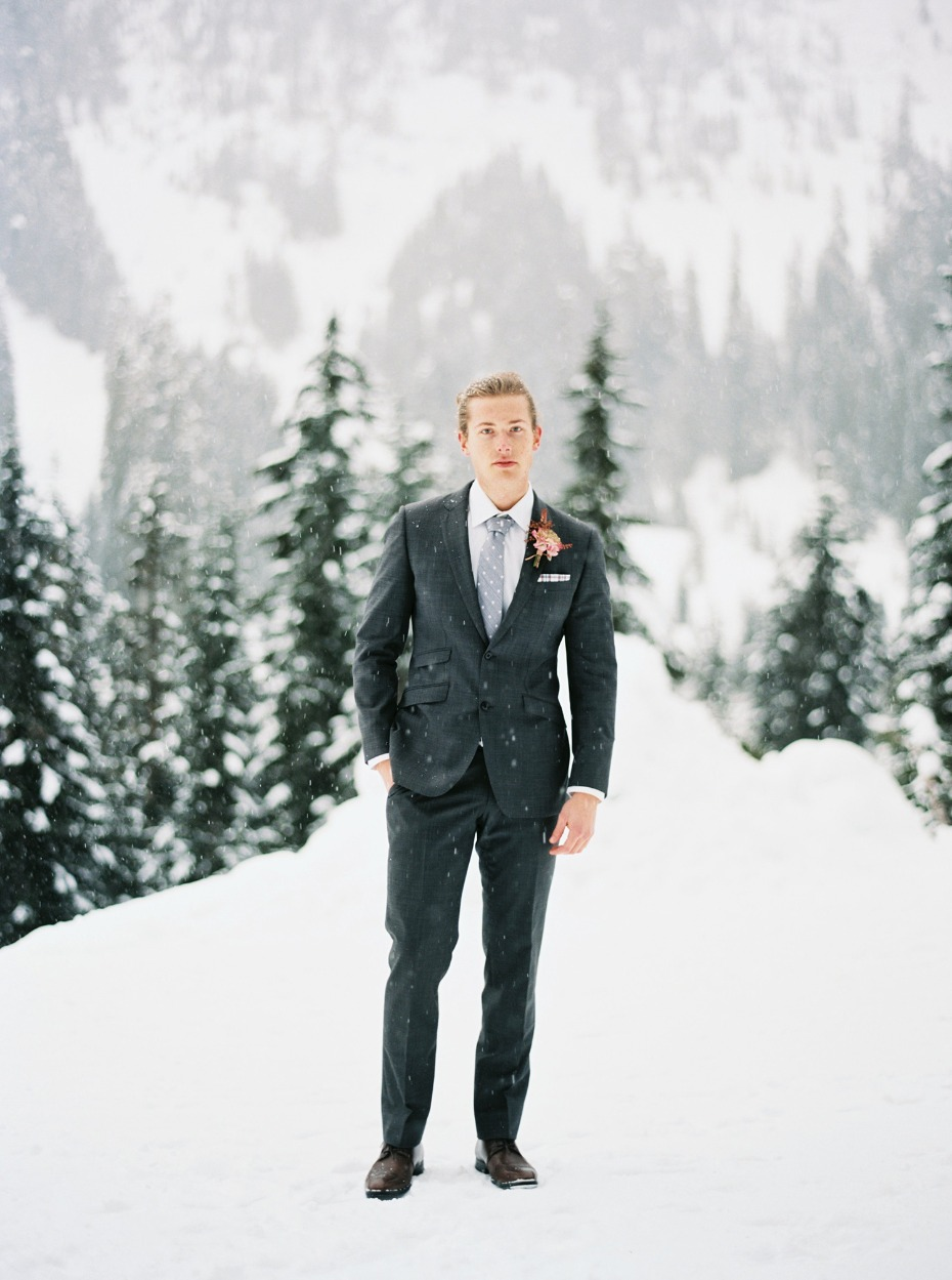 groom in dark grey suit