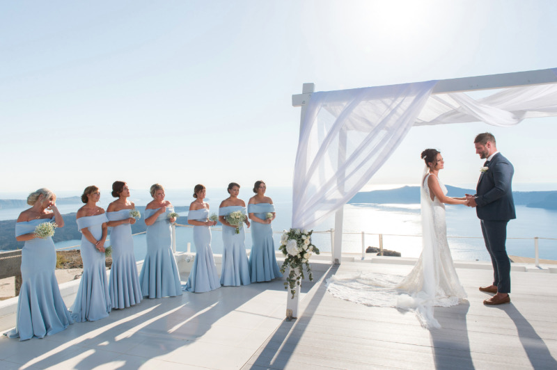 Bright blue bridesmaids dresses fro this outdoor Santorini wedding