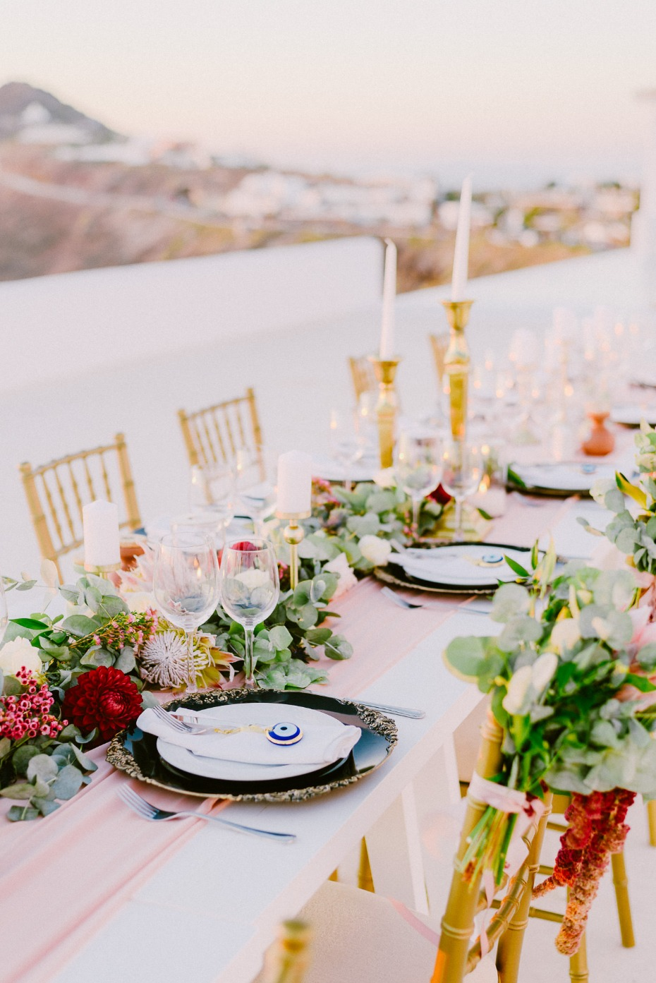 family style wedding seating with gold and pink decor