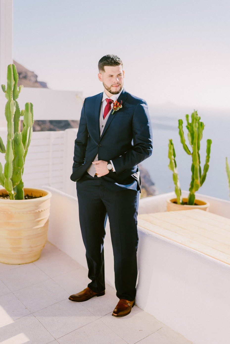 formal groom style with red tie and light grey vest