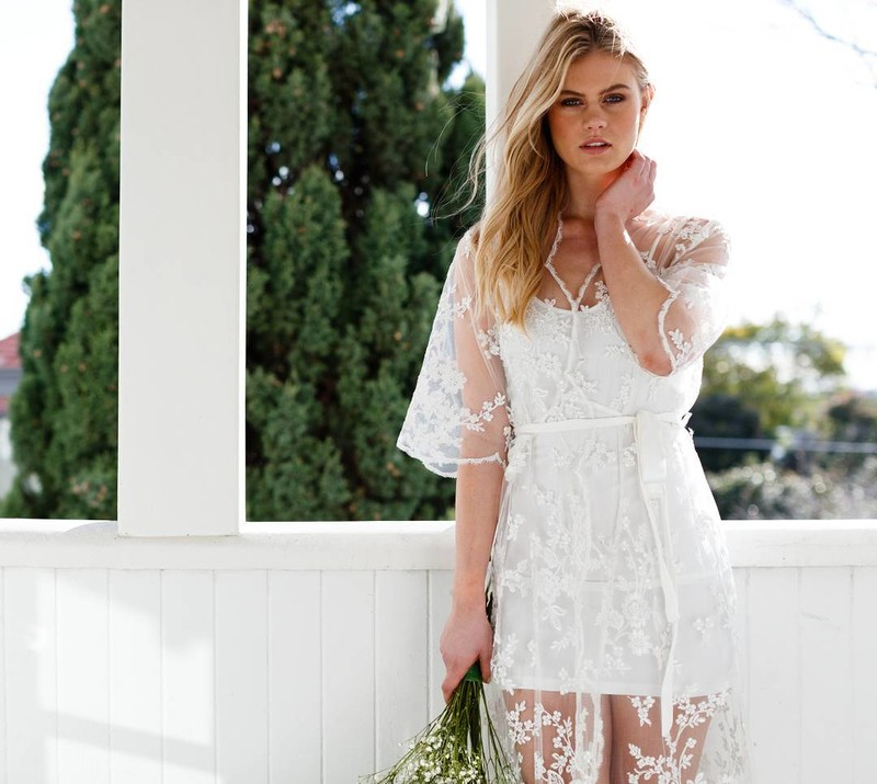 Every bride-to-be needs a beautiful getting ready robe for your photos. This floor length number features delicate lace details,
