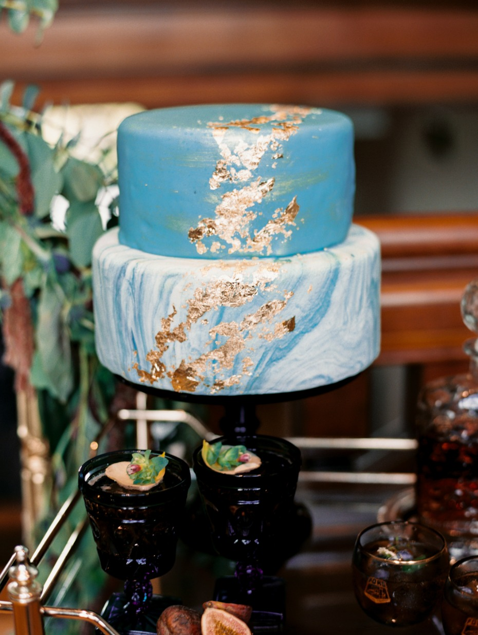 light blue marbled wedding cake with gold leaf accents