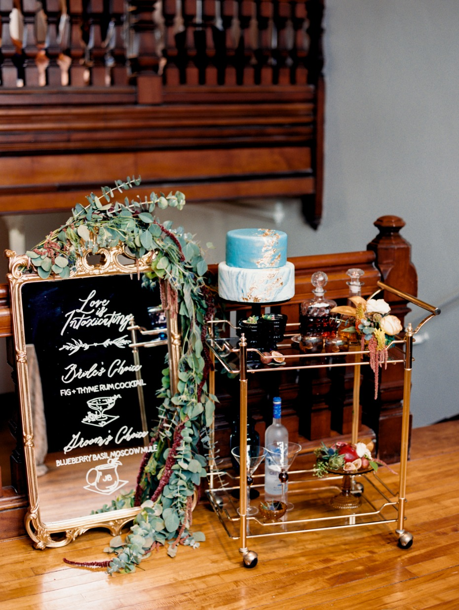 mirror wedding sign and self serve bar and cake table