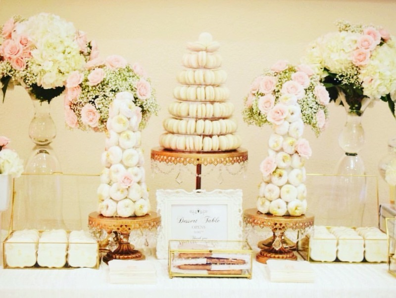 Pretty Wedding Dessert Table with macaron and donuts towers on Opulent Treasures Gold Chandelier Cake Stands!