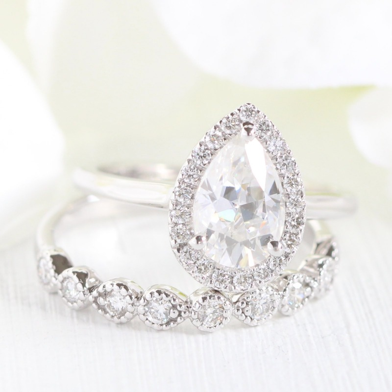 A classic pear shaped halo engagement ring paired with a unique milgrain wedding band ~