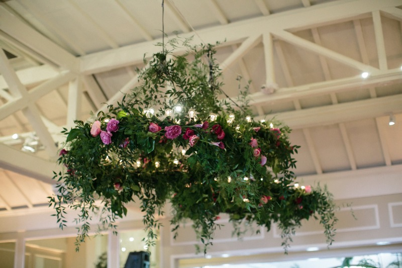 Floral Chandeliers hung over the dance floor at this formal, garden inspired summer wedding in California.