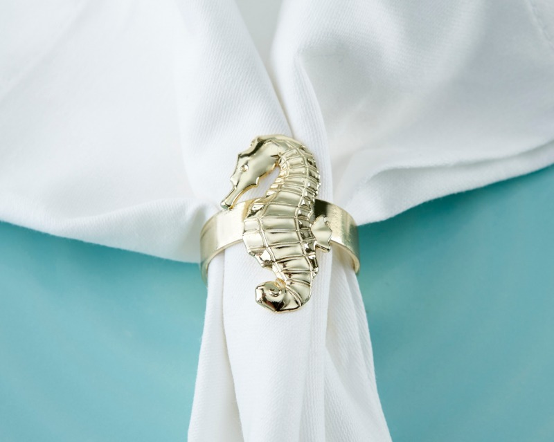 A great tablescape is essential for your seaside-themed wedding or bridal shower. Kate Aspen's Gold Seahorse Napkin Rings add a delicate