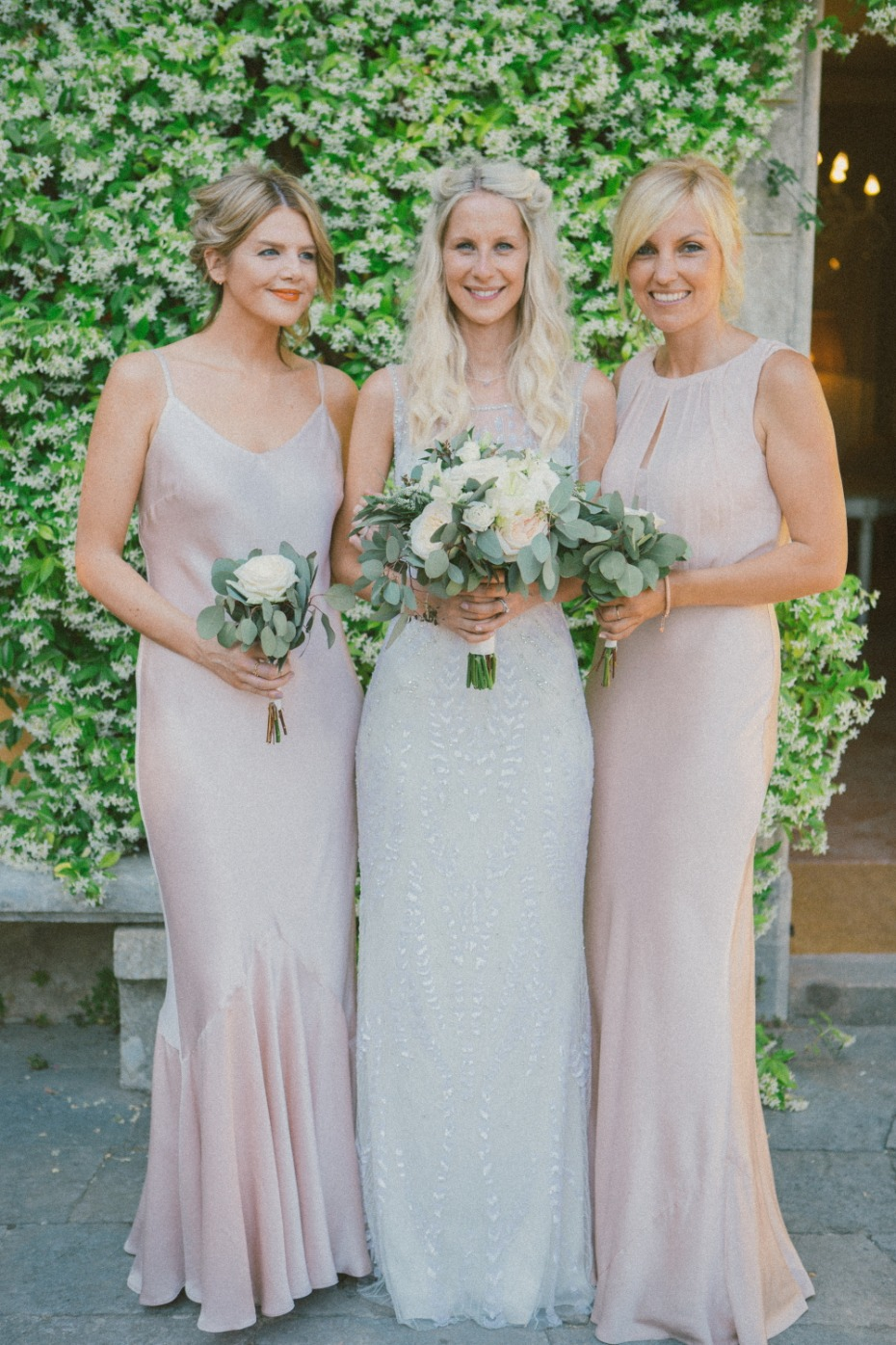 Bride and bridesmaids in blush wedding dress