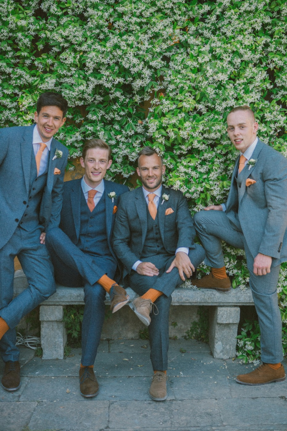 Grey and orange groomsman suits