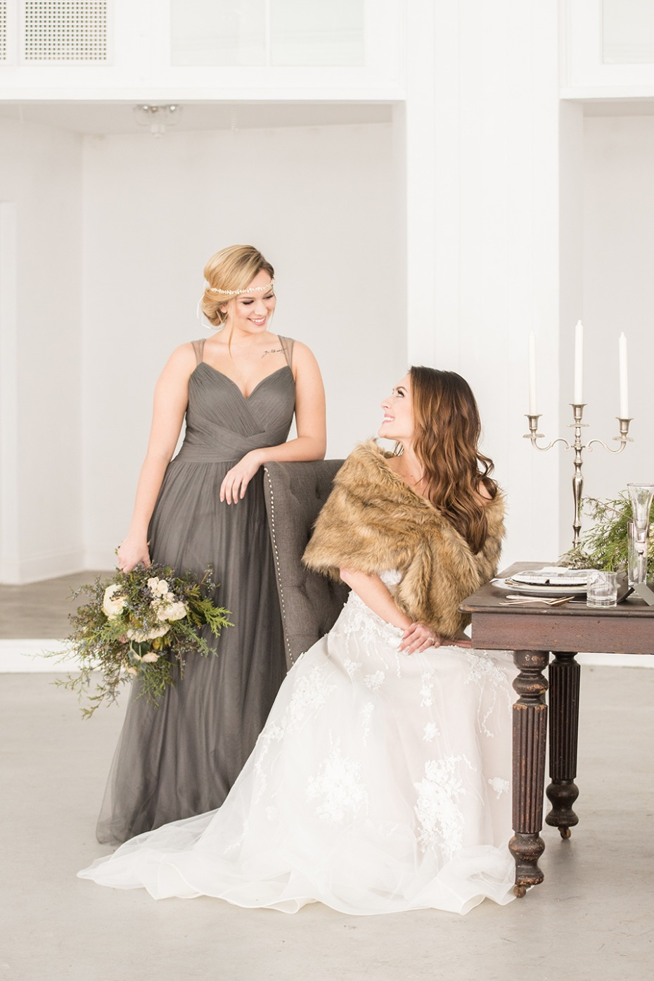 fur shall for the bride and elegant grey dress for the bridesmaid