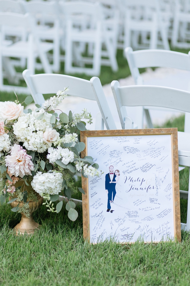 How STUNNING is this setup? We're loving those gorgeous flowers with our guest book alternative. Customize your big day with one of