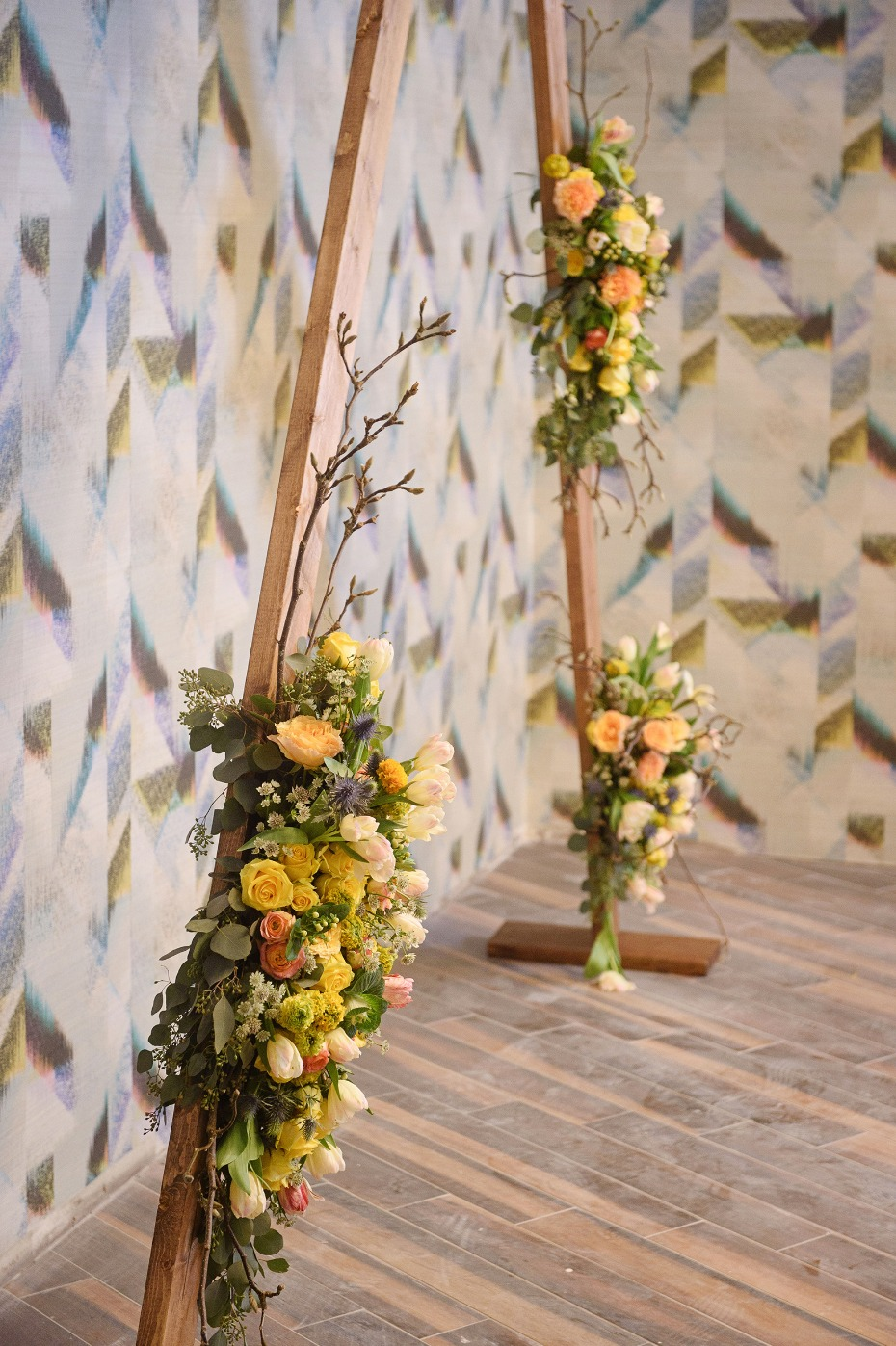 Triangle wedding arch with florals