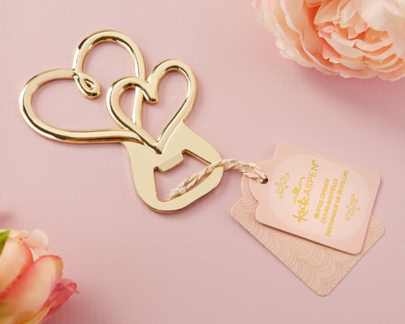 Bring a little love to every guest with Kate Aspen's Gold Double Heart Bottle Opener. Featuring a two interlocking gold-toned hearts
