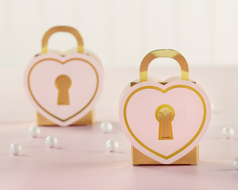 Each favor box features a heart-shaped padlock design with pink and gold accents to keep favors safe and sound while guests enjoy your