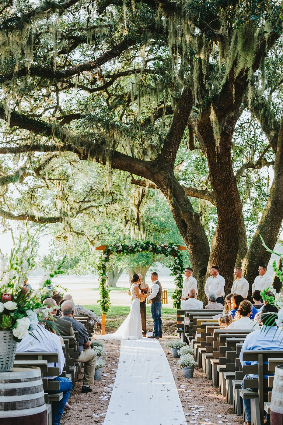 Romantic ceremony under old oak trees