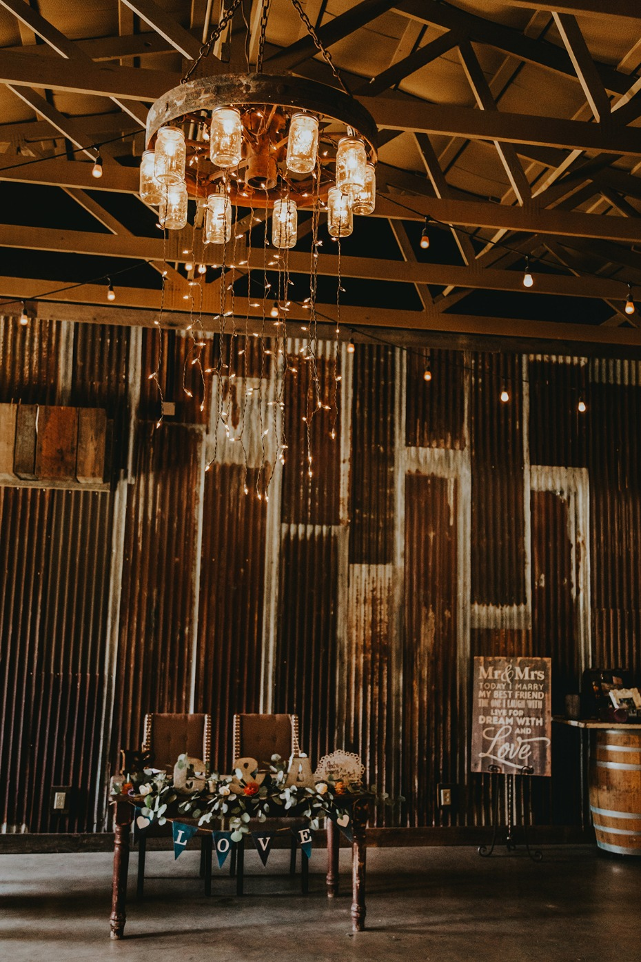 Rustic sweetheart table with a mason jar chandelier