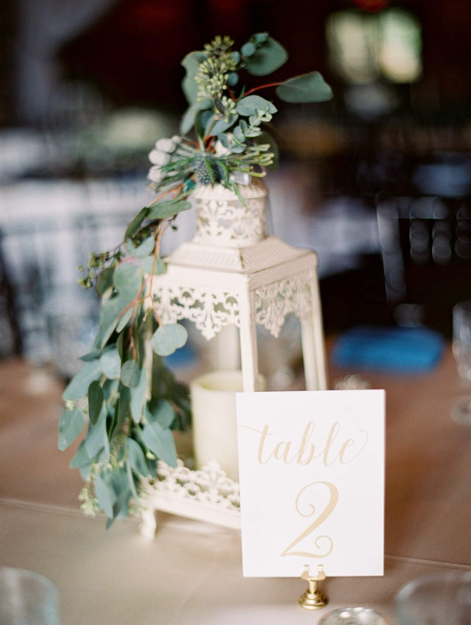 white lantern and table number centerpiece