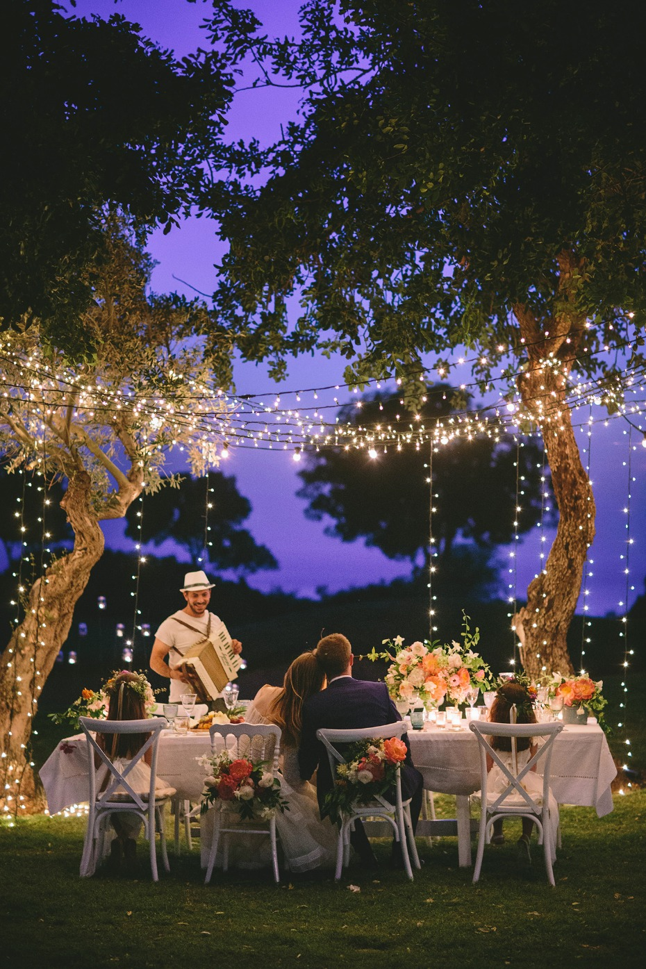 Whimsical garden wedding with twinkle lights