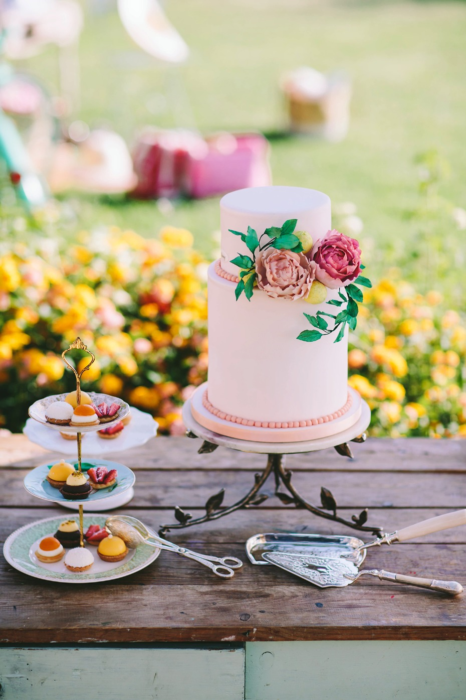 Floral accented wedding cake with tasty pastries