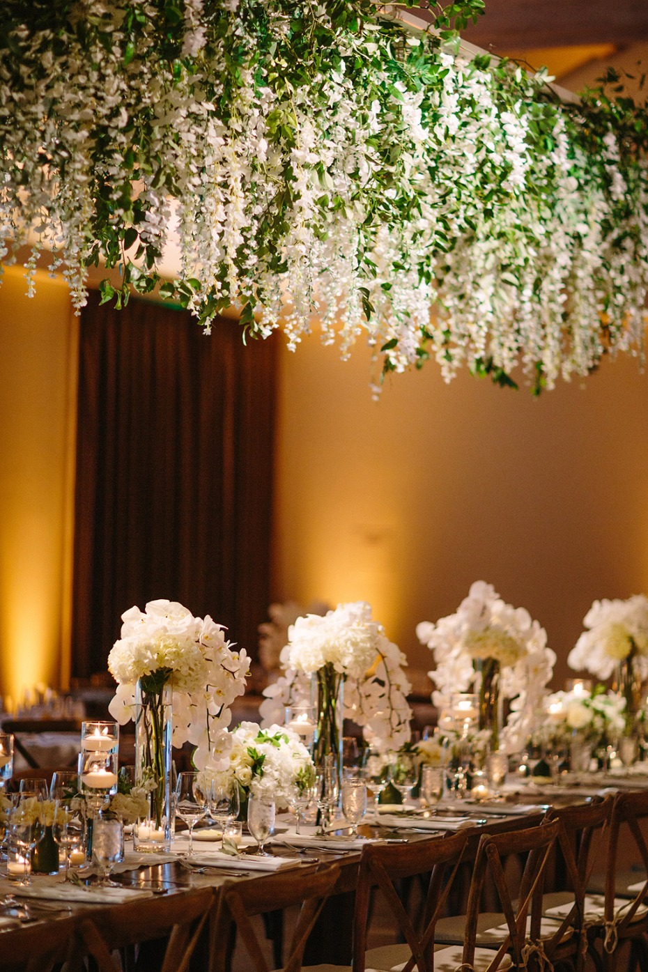 floral chandelier above the wedding party table