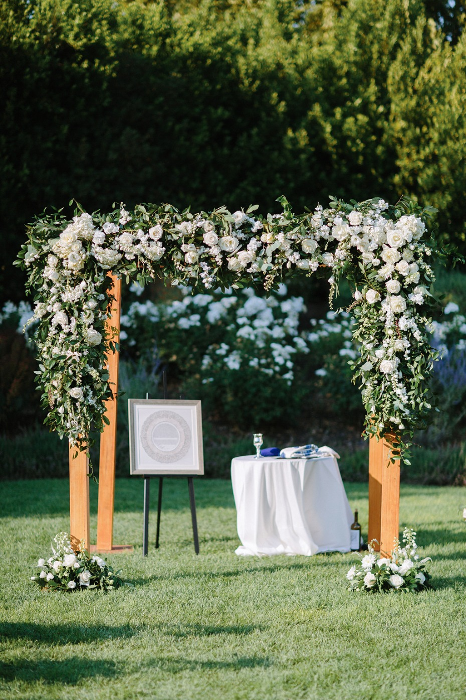 flower draped wedding arch