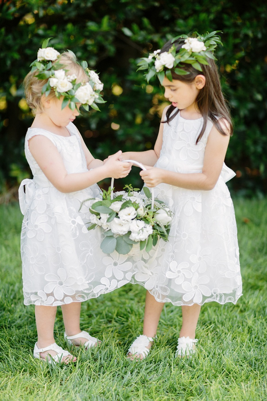 flower girls in white with flower halos