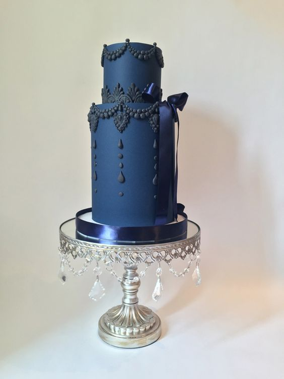 Something Blue!! Blue tiered wedding cake on antique silver chandelier cake stand created by Opulent Treasures