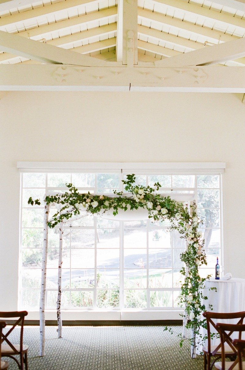 Garden style chuppah in an indoor setting.