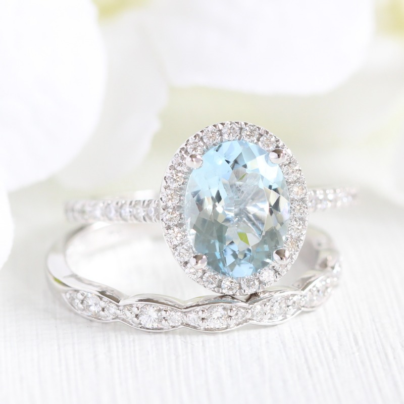 La More Design's Oval Aquamarine Halo Diamond Engagement Ring with Scalloped Diamond Wedding Ring makes for a gorgeous and elegant