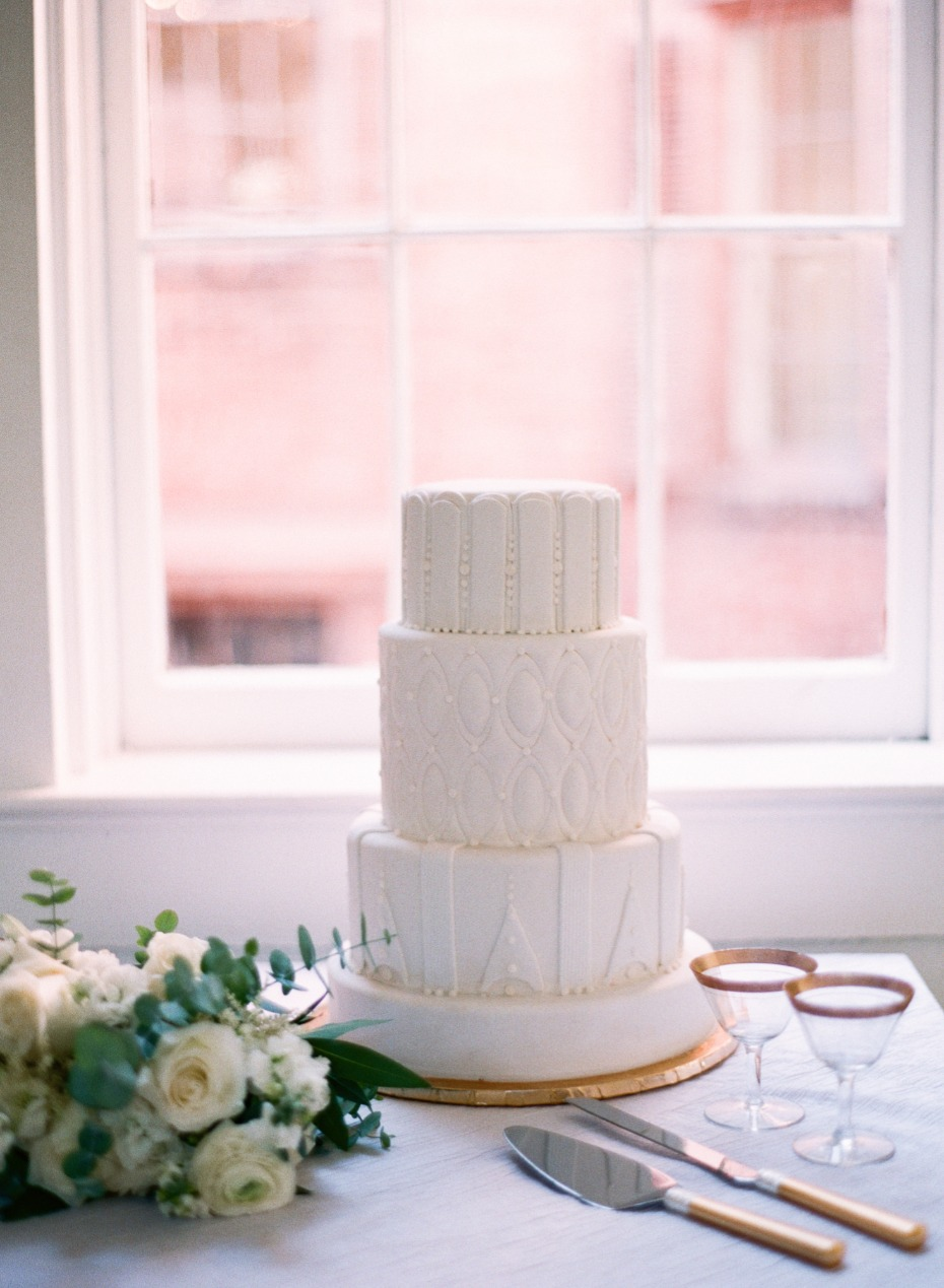 all white wedding cake with unique frosting textures