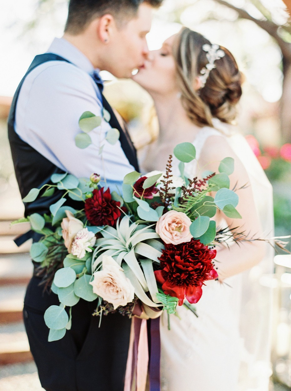 Cute bouquet kiss photo