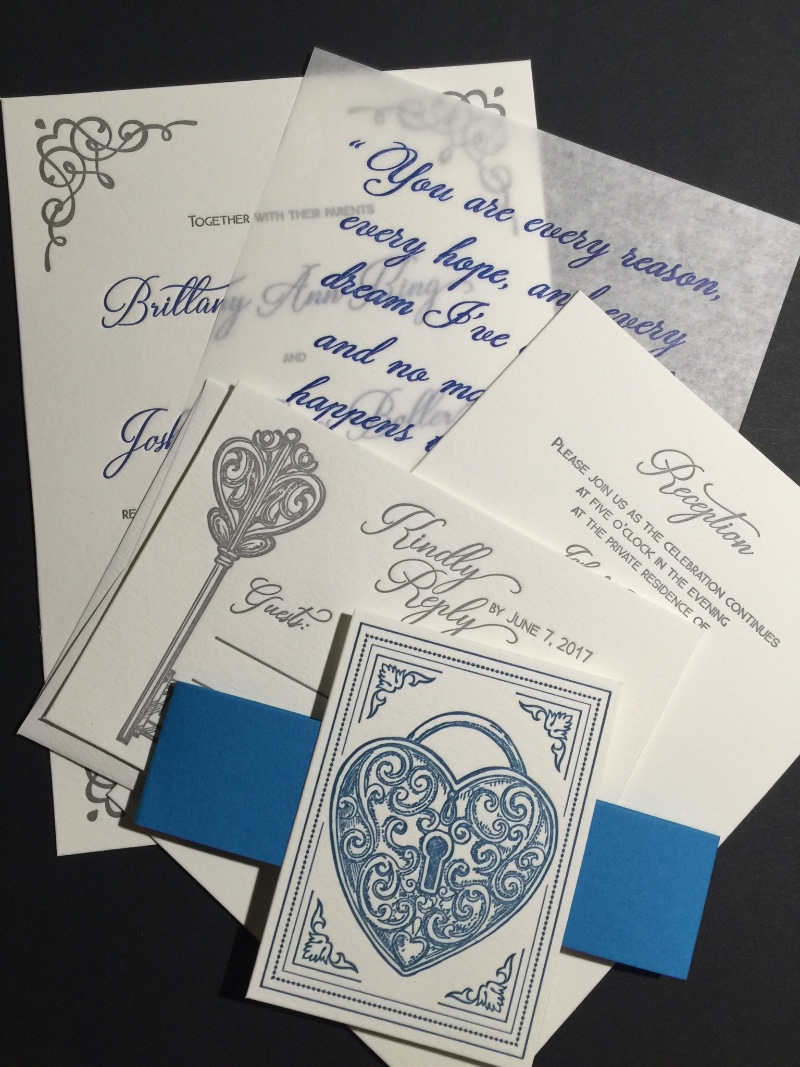A Lock and Key letterpress wedding invitation suite in a beautiful blue and silver color palette, by Lucky Invitations.