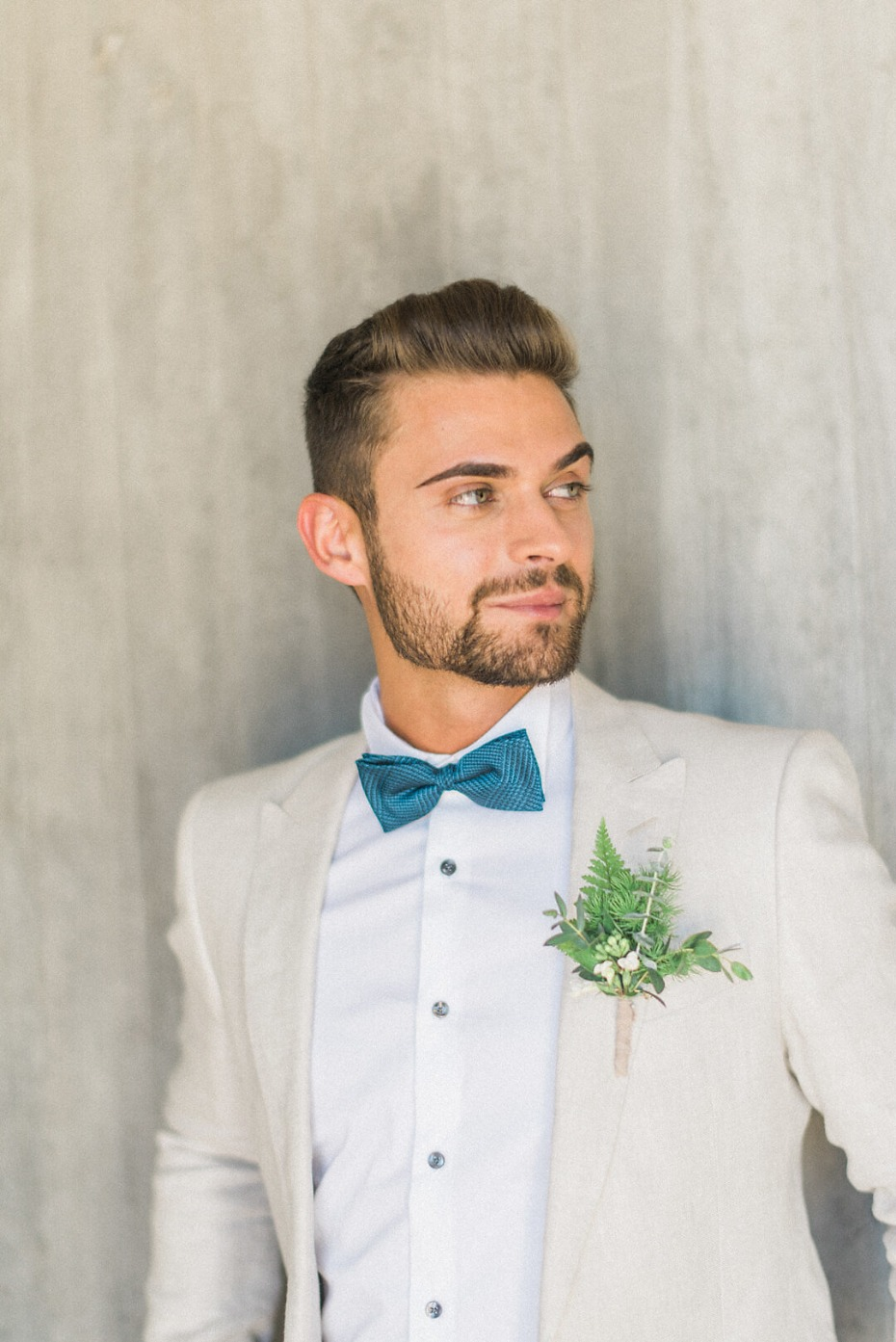 modern groom style in cream and blue