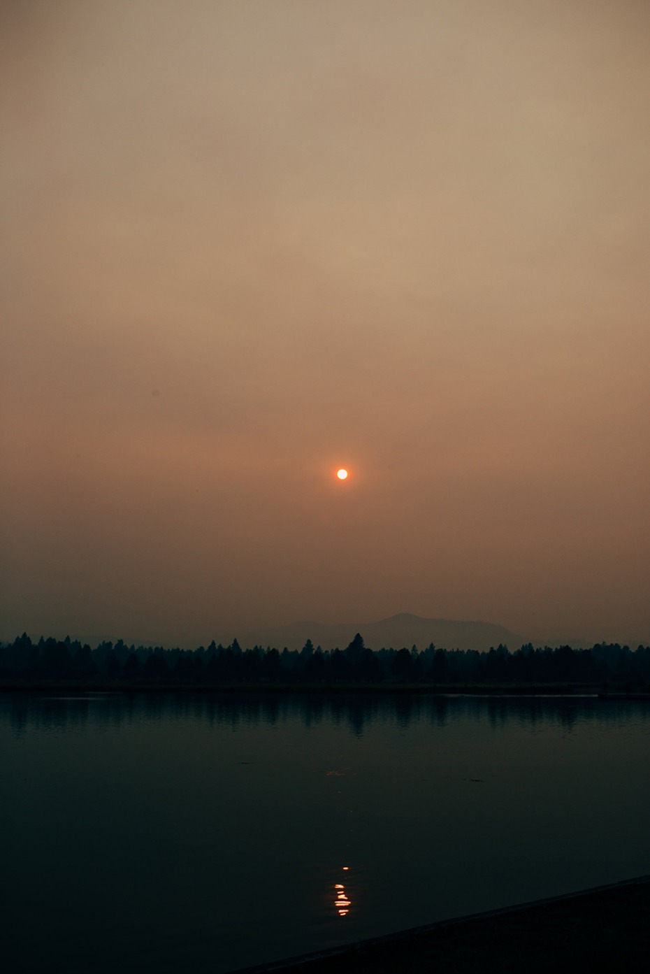 setting smoky sun