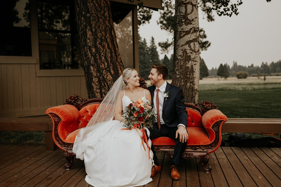 cute bride and groom photo on vintage couch