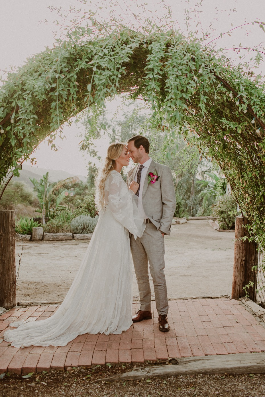 Greenery arch for this tropical boho wedding
