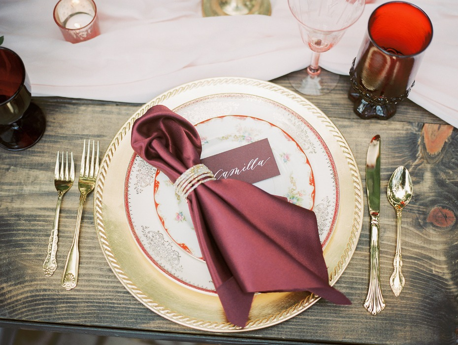 Burgundy and gold place setting