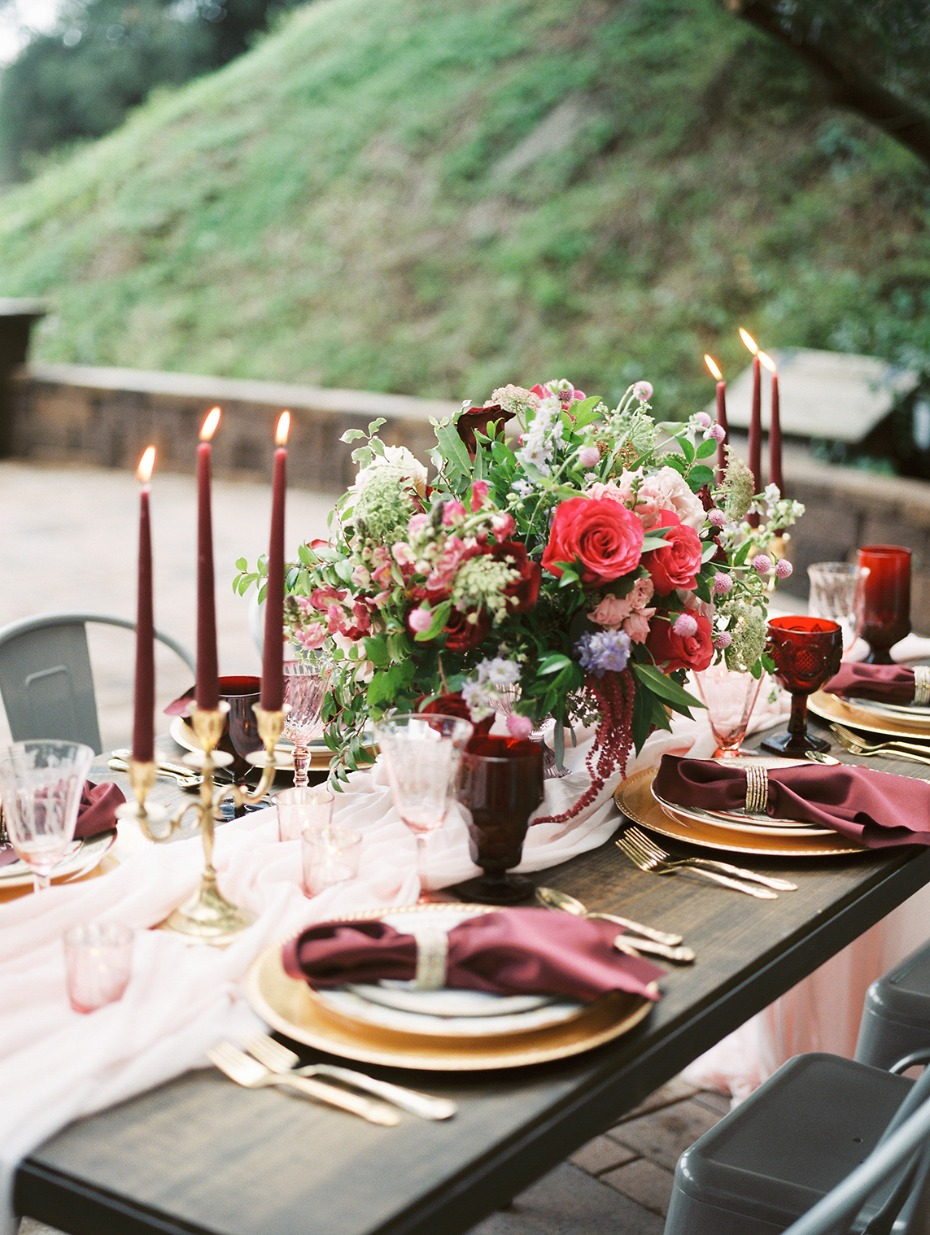 Romantic table setting in red, gold and blush