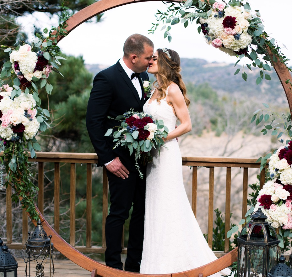 round wedding backdrop with floral accents