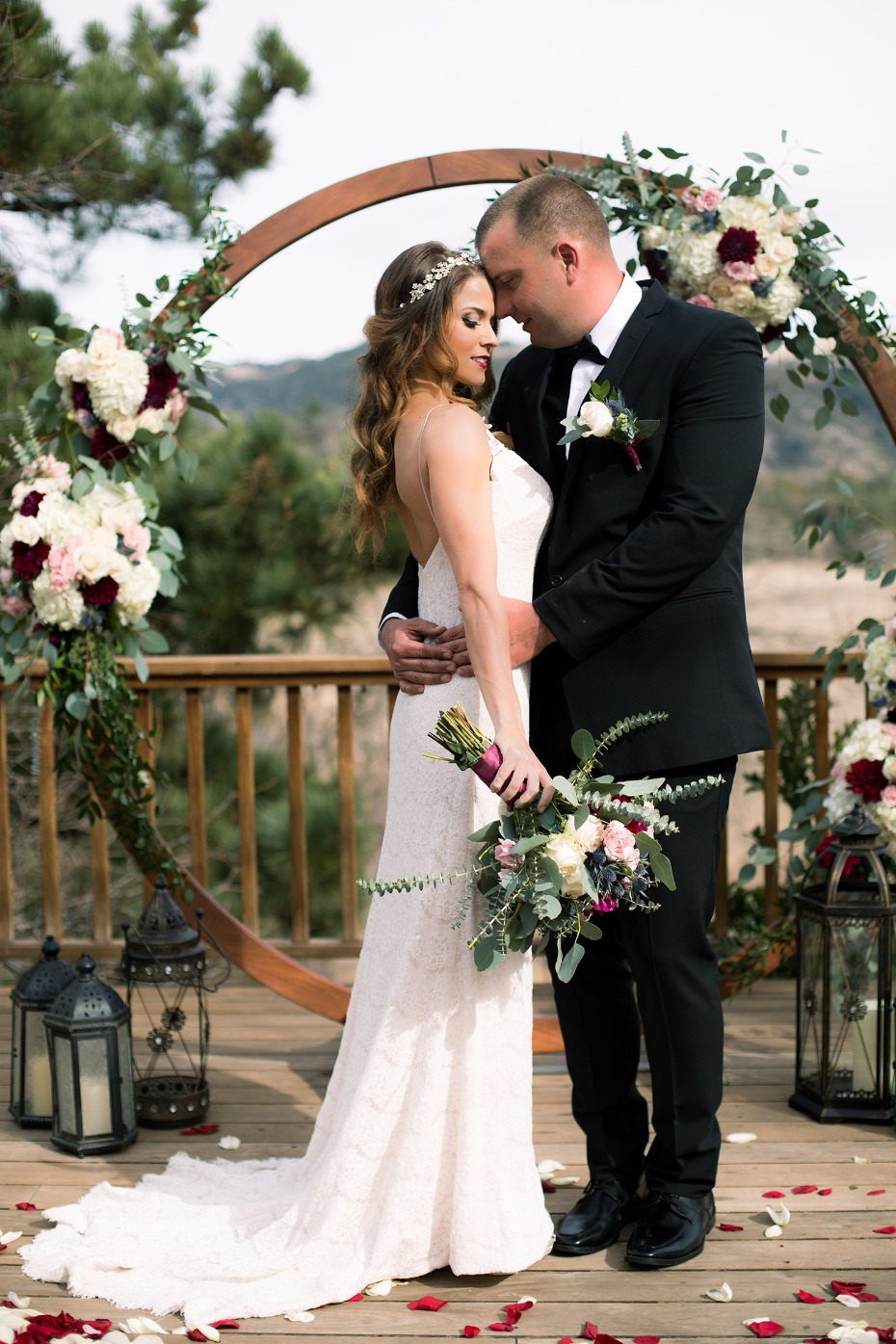 romantic bride and groom with modern winter wedding backdrop