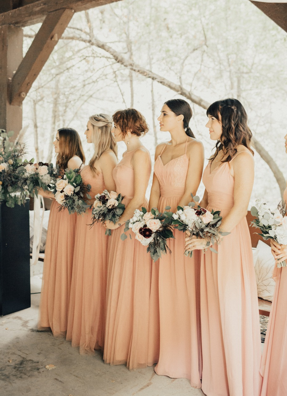 bridesmaids in matching pink dresses
