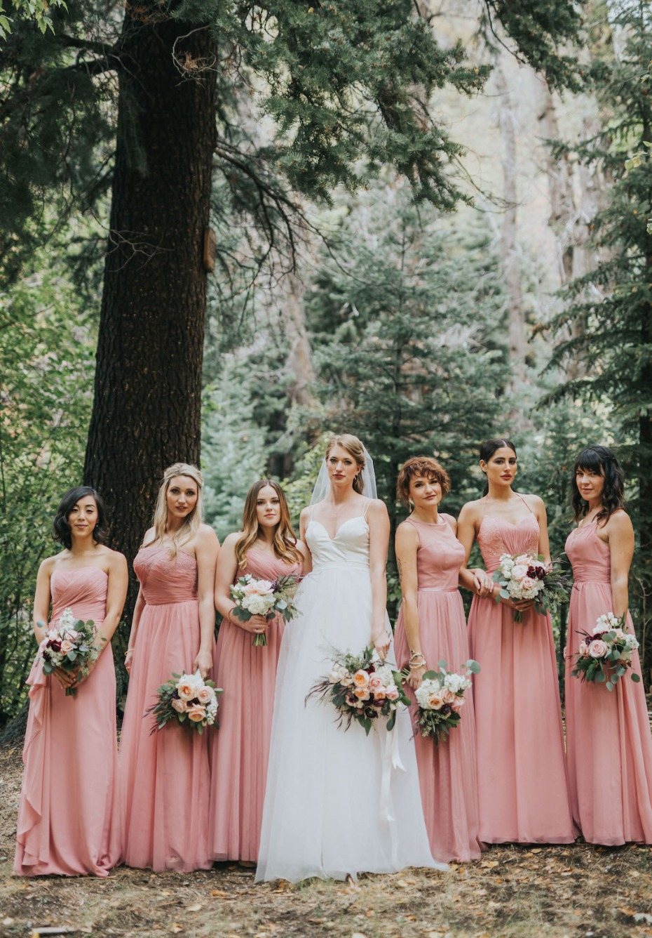 bride and her bridesmaids in matching pink