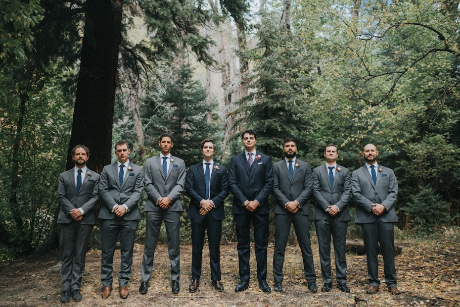 the groom and his men in varying shades of grey and blue